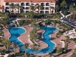Splash Lagoon Pool with Water Slide, Water Falls, Pool Volleyball Net, and Pool Basketball Net