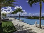 ACQUA...4 + 1 BR villa, offers spectacular views of the Lagoon, the ocean and St Maarten
