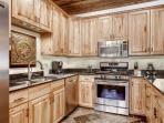 Gourmet kitchen features granite counters, attractive cupboards & stainless steel appliances (french door fridge...