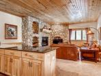 Open concept living between the kitchen and family room. The breakfast bar can seat four (4) anding the dining room can...