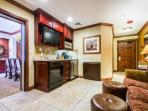 Living suite (2) with gourmet kitchenette, comfortable living area with HDTV and large bedroom suite.