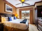 Guest bedroom (2) features a king size bed, high end linens/bedding, dresser, HDTV and private bathroom.