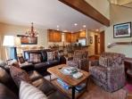 Large living room / great room that features leather furnishings, vaulted ceilings, hardwood mountain finishings that...