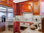 Gourmet kitchen with stainless steel appliances (french door fridge, stove/oven, dishwasher) and granite counters.