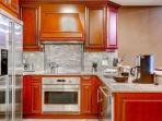 Spacious and fully stocked kitchen for all of your cooking and entertaining needs.