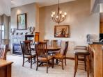 Formal dining area with comfortable seating for six (6). Additional seating is available at the breakfast bar and it...