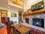 """Living room area with gas fireplace, Surround sound 50"""" HDTV , cable television, WiFi, DVD player and Nintendo Wii."""