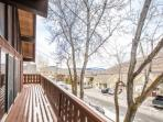 The first of two balcony's wraps around the front and sides of the home and offers bench seating, mountain views & a...