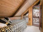 The fourth bedroom (4) has a twin bed, slanted ceiling and access to the shared balcony.