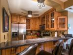 The new Chef's kitchen features brand new stainless steel appliances, beautiful hardwood cabinetry, granite counter...
