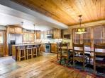 The chef's kitchen and formal dining room is warm, inviting and accented perfectly with new hardwood flooring, mountain...