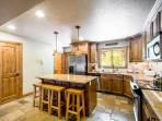 The gourmet kitchen looks out to the formal dining room and spacious living area. From here you can access your private...