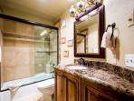 The fourth bathroom (4) was also recently renovated and has a dark granite countertop with Kohler sink, stone tile...