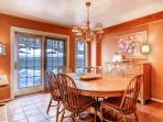 Dining room with seating for 6, door opens to deck with Jacuzzi hot tub.