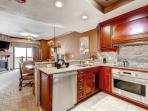Gourmet custom kitchen with top of the line stainless steel appliances and cherry cabinets.