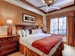 Master bedroom with king size bed, high quality bedding & linens, flatscreen HDTV, dressers, oversized windows with...