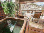 Private and spacious outdoor covered balcony/patio with views of Deer Valley and private Jacuzzi hot tub.