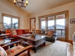 Spectacular views from the main living room with custom furnishings, hand-picked decor / art / photography, central...