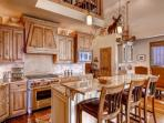 Gourmet kitchen with stainless steel appliances (microwave, gas stove, dishwasher, sub zero fridge), granite counters...