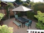 Our back patio is spacious, with a garden and gas BBQ.