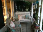 Front porch with swing.  Great spot to view the ocean and cool off after a warm summer day.