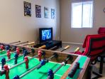 Entertainment room with foosball and xbox, just bring your favourite games.