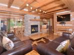 Living room with leather sofas and fireplave