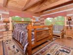 2nd floor 'family' bedroom with 2 queen beds and 2 twin daybeds; exposed beam ceilings, log walls