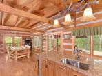 Modern kitchen with custom cabinetry, chiseled edge granite countertops, stainless appliances