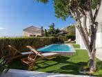 Grounds (700 square meters) with a southern aspect and private, heated pool.