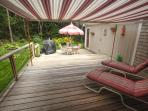 Huge Outdoor room w/ retractible electric awning 2 level deck overlooking herb garden