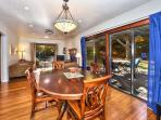 Dining room with easy access to large deck. Great for spring and summer dining and relaxing