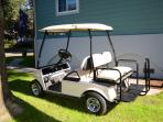 A four seater golf cart for your use when you stay with us!