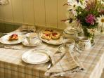 Enjoy your complimentary Devon Cream Tea inside the Shepherd's Hut if the weather turns inclement