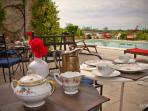 Wake up and enjoy breakfast poolside.