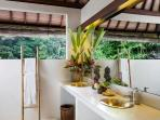 The beautiful main bathroom complete with indoor and outdoor shower, double basins and jungle views.