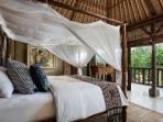 Comfortable and beautifully decorated, the main bedroom suite provides a wonderful personal space.