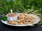 Free range chicken satays with peanut sauce.