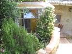 Villa La Rogaia apartment La Mimosa - entrance and conservatory