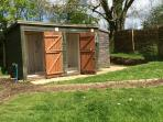 The 2 shower rooms from the outside, behind is another useful room with fridge, freezer, books etc