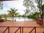 Waterfront villa with expansive patio deck.