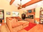Front Family room w/ TV, free cable movies, DVD player, DVD movie library & wood burning fireplace.
