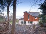 The view of Woodland Cottage and the sea from its private enclosed land