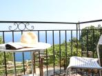 Upper balcony...to relax and enjoy the total blue of Aegean Sea