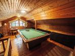 A loft with a pool-table