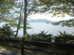 The lake is next to the deck with the Ossipee Mountains in the distance across the lake.