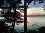 The lake and mountains at dusk from the deck of Ossipee Lake House.  Listen to the loons at night.