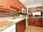 Renovated, modern, fully equipped kitchen with granite counters