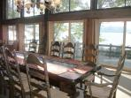 Four sets of sliding glass doors open from great room out onto deck and provide full lake views.