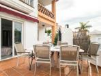 moveable dining area on the terrace surrounding villa showing also purpose built barbecue